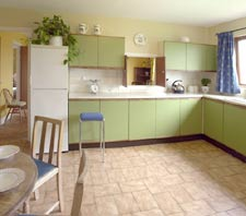 The Kitchen Is Adjacent To Dining Room With A Serving Hatch